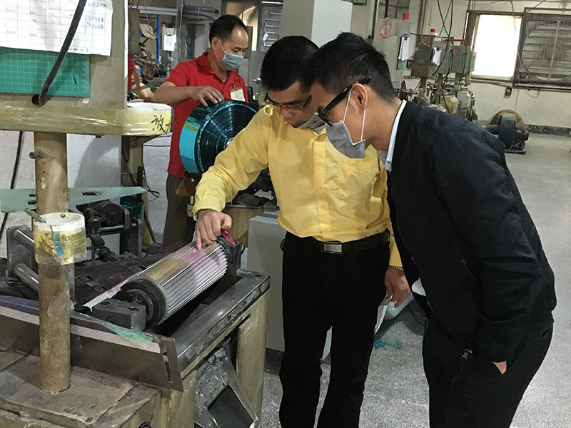 A Chinese customer was following our manager studying the function of cutting machine. It's a important line during the producti